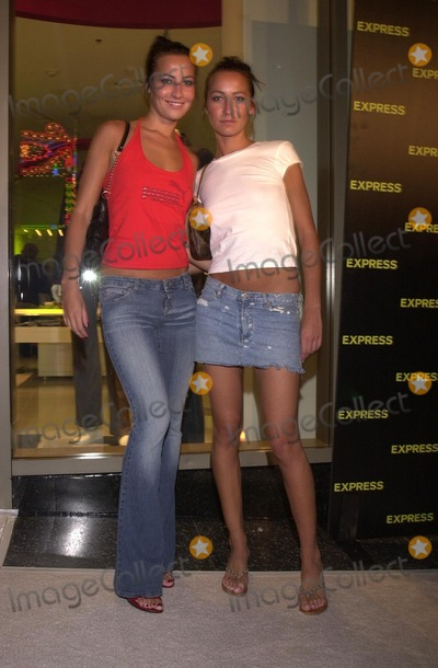 Teena Collins Photo - Nikki and Teena Collins at the grand opening for the new EXPRESS Flagship store opening at Hollywood and Highland Hollywood CA 08-01-02