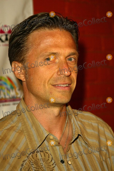 George Tasudis Photo - George Tasudis at a casting call party for the Palm Casino  Resort Palm Girl competition Xes Hollywood CA 08-20-04