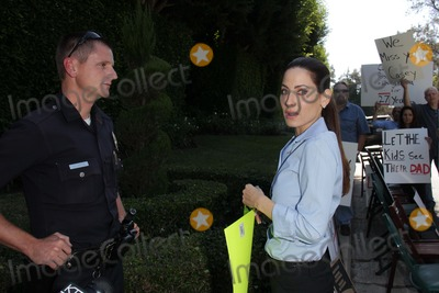 Casey Kasem Photo - Kerri Kasem talks to the policeat a protest involving Casey Kasems children brother and friends who want to see him but have been denied any contact  Private Location Holmby Hills CA 10-01-13