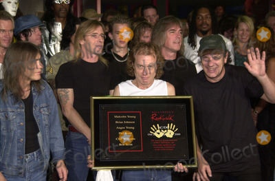 Angus Young Photo -  Cliff Williams Brian Johnson Angus Young Malcolm Young at the ceremony where they were inducted into Sunset Blvds Rockwalk 09-15-00