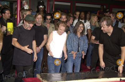 ACDC Photo -  ACDC at the ceremony where they were inducted into Sunset Blvds Rockwalk 09-15-00