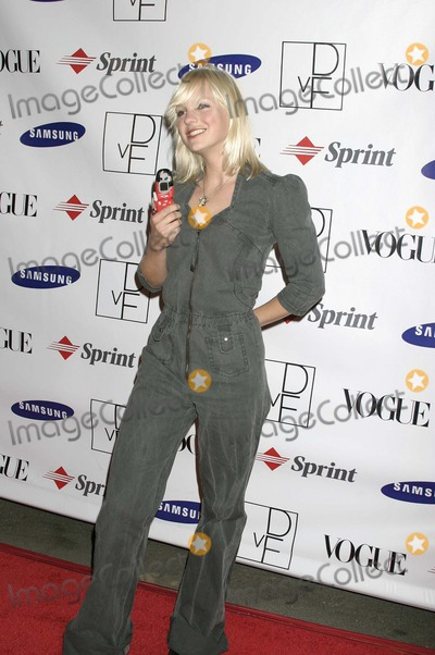 Anna Faris Photo - Anna Faris at a party thrown by Samsung and Vogue to launch the Limited Edition Diane Von Furstenberg Designer Mobile Phone Astra West Pacific Design Center West Hollywood CA 10-15-04