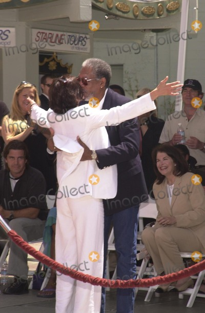 Ashley Judd Photo - Ashley Judd and Morgan Freeman at Freemans hand and foot print ceremony at the Chinese Theater Hollywood 06-05-02