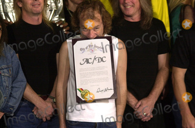 Angus Young Photo -  Angus Young at the ceremony where they were inducted into Sunset Blvds Rockwalk 09-15-00