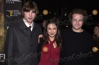 Ashton Kutcher Photo -  Ashton Kutcher  Mila Kunis   Danny Masterson at the premiere of USA Films Traffic in Beverly Hills 12-14-00