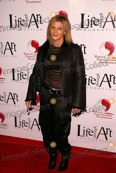 Ginger Lynn Photo - Ginger Lynn at the First Annual Red Party To Benefit The Life Through Art Foundation Private Estate Beverly Hills CA 12-13-03