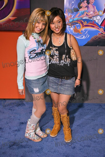 Ashley Tisdale Photo - Ashley Tisdale and Brenda Song at Walt Disney Home Entertainments worldwide DVD debut of Aladdin Special Edition at the El Capitan Entertainment Centre Hollywood CA 09-30-04