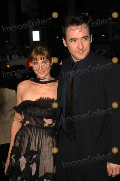 Amanda Peete Photo - Amanda Peet and John Cusack at the premiere of Columbia Pictures Identity at Manns Chinese Theater Hollywood CA 04-23-03