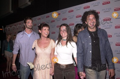 Alyssa Milano Photo - Alyssa Milano and Holly Marie Combs with dates at the grand opening of the PlayStation 2 Hotel at the Standard in downtown Los Angeles as part of the 2002 E3 conference 05-21-02
