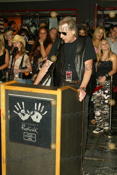 Iron Maiden Photo - Jim Ladd at the ceremony honoring Iron Maiden with induction in to the Hollywood Rockwalk Rockwalk HollywoodCA 08-19-05