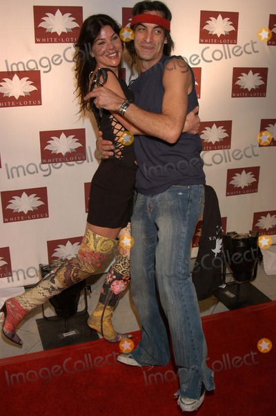 Amber Elias Photo - Adam Saaks and Amber Elias at the grand opening of the new Hollywood nightclub White Lotus Hollywood CA 03-07-03