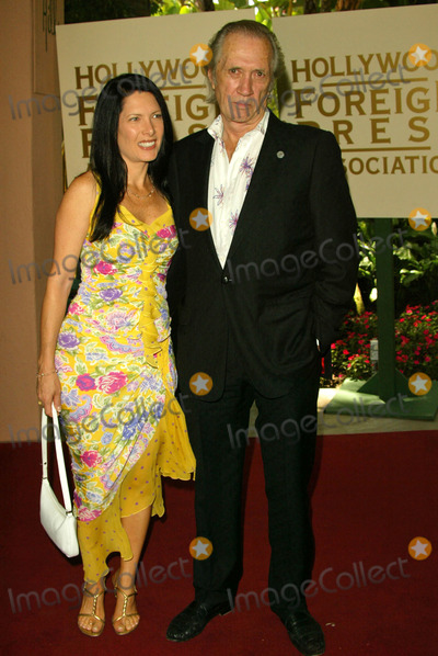 Annie Bierman Photo - Annie Bierman and David Carradine at the Hollywood Foreign Press Associations Annual Installation Luncheon Beverly Hills Hotel Beverly Hills CA 08-11-04