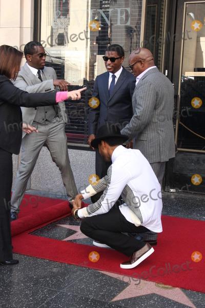 Antonio LA Reid Photo - LOS ANGELES - OCT 10  Usher Sean Combs Kenny Babyface Edmonds Antonio LA Reid at the Kenny Babyface Edmonds Hollywood Walk of Fame Star Ceremony at Hollywood Boulevard on October 10 2013 in Los Angeles CA