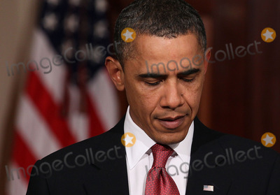 Mark Wilson Photo - United States President Barack Obama looks down while making a statement about the decision of President Hosni Mubarak of Egypt not to seek another term as Egyptian President at the White House on Thursday February 1 2011 in Washington DC Earlier today the embattled Mubarak announced that he would not seek reelection after one million people rallied across Egypt calling for Mubarak to give up power Photo by Mark Wilson PoolCNP-PHOTOlinknet