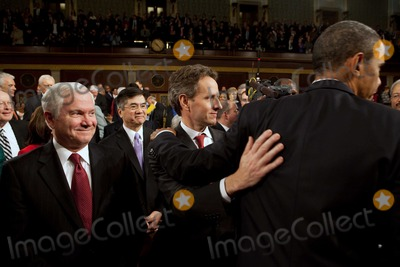 Timothy F Geithner Photo - United States Secretary of the Timothy F Geithner pats US President Barack Obama on the back as he leaves the House Chamber at the conclusion of his State of the Union address Wednesday January 27 2010 At left is US Secretary of Defense Robert M GatesMANDATORY CREDIT Pete SouzaWhite House-CNP-PHOTOlinknet