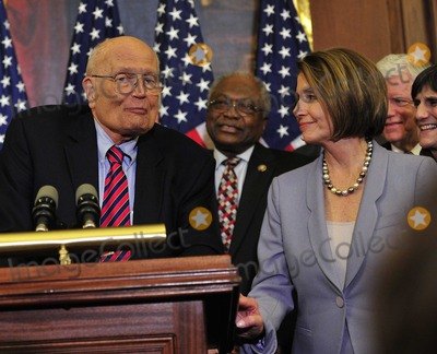 House Speaker Nancy Pelosi Photo - RESTRICTED NO NEW YORK OR NEW JERSEY NEWSPAPERS WITHIN A 75 MILE RADIUS OF NYCUnited States Representative John Dingell (Democrat of Michigan) left US House Majority Whip Jim Clyburn (Democrat of South Carolina) center and US House Speaker Nancy Pelosi (Democrat of California) right celebrate the passage of the health care reform bill in the US Capitol in Washington DC early Monday morning March 22 2010    Photo by Ron Sachs-CNP-PHOTOlinknet