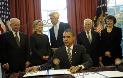 Robert gates Photo - United States President Barack Obama signs the New START Treaty during a ceremony in the Oval Office of the White House with from left US Secretary of Defense Robert Gates US Secretary of State Hillary Rodham Clinton US Senator John Kerry (Democrat of Massachusetts) US Senator Richard Lugar (Republican of Indiana) US Senator Dianne Feinstein (Democrat of California) Photo by Leslie E Kossoff  PoolCNP-PHOTOlinknet