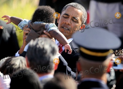 Alex Wong Photo - United States President Barack Obama holds up a baby as he greets victims families during an event to mark the anniversary of the 911 terrorist attacks at the Pentagon Memorial Saturday September 11 2010 in Arlington Virginia Obama delivered remarks and laid a wreath during the event on the 9th anniversary of the tragedy  Photo by Alex WongPoolCNP-PHOTOlinknet
