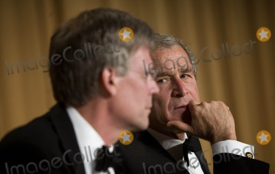 Tony Snow Photo - Washington DC  April 21 2007United States President George W Bush (R) looks to his spokesperson Tony Snow (L) who has not served since cancer was discovered during a surgery at the White House Correspondence Association Dinner April 21 2007 in Washington DC  Comedian Rich Little hosted and provided entertainment for Bush White House reporters their guests and celebrities Digital Photo by Brendan SmialowskiPOOL-CNP-PHOTOlinknet