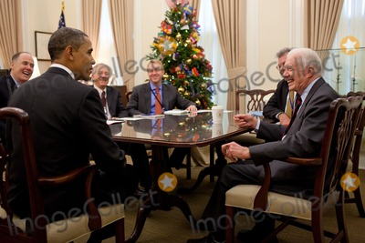 Jimmy Carter Photo - OBAMA MEETS JIMMY CARTERUnited States President Barack Obama talks with former President Jimmy Carter who was attending a meeting in National Security Advisor Tom Donilons office in the White House November 30 2010 Photo by Pete SouzaWhite House via CNP-PHOTOlinknet