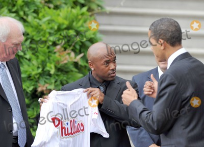 Jimmy Rollins Photo - Washington DC - May 15 2009 -- United States President Barack Obama right looks at the jersey presented to him by shortstop Jimmy Rollins center as he welcomes the 2008 Baseball World Champion Philadelphia Phillies to the White House  Phillies manager Charlie Manuel looks on from leftDigital Photo by Ron SachsPOOL-CNP-PHOTOlinknet