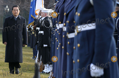 Alex Wong Photo - WASHINGTON DC - JANUARY 19  Chinese President Hu Jintao (L) inspects the honor guards as during a state arrival ceremony at the South Lawn of the White House January 19 2011 in Washington DC Hu and President Obama will hold a press conference at the White House later todayPhoto by  Alex WongPoolCNP-PHOTOlinknet