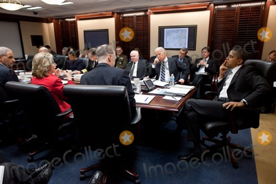 Robert gates Photo - United States President Barack Obama and US Vice President Joe Biden hold a meeting on Afghanistan and Pakistan with the national security team in the Situation Room of the White House March 3 2011 Visible in the photo from right are President Obama Vice President Biden US Secretary of Defense Robert Gates  Chairman of the Joint Chiefs of Staff Admiral Michael Mullen US Ambassador to  the United Nations Susan Rice Attorney General Eric Holder  US secretary of State Hillary Rodham Clinton and National Security Advisor Tom DonilonPhoto by Pete SouzaWhite HouseCNP-PHOTOlinknet