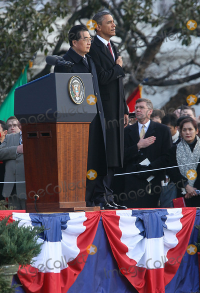 Alex Wong Photo - WASHINGTON DC - JANUARY 19 (AFP OUT) US President Barack Obama (R) and Chinese President Hu Jintao (L) participate during a state arrival ceremony at the South Lawn of the White House January 19 2011 in Washington DC Hu and President Obama will hold a press conference at the White House later today  Photo by  Alex WongPoolCNP-PHOTOlinknet