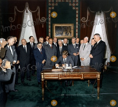 President Kennedy Photo - United States President John F Kennedy signs the Limited Nuclear Test Ban Treaty in the White House Treaty Room on October 7 1963 From left to right William Hopkins US Senator Mike Mansfield (Democrat of Montana) John J McCloy Adrian S Fisher US Senator John Pastore (Democrat of Rhode Island) W Averell Harriman US Senator George Smathers (Democrat of Florida) US Senator JW Fulbright (Democrat of Arkansas) US Secretary of State Dean Rusk  US Senator George Aiken (Republican of Vermont) President Kennedy US Senator Hubert H Humphrey (Democrat of Minnesota)  US Senator Everett Dirksen (Republican of Illinois) William C Foster US Senator Howard W Cannon (Democrat of Nevada) US Senator Leverett Saltonstall (Republican of Massachusetts) US Senator Thomas H Kuchel (Republican of California) US Vice President Lyndon B Johnson White House Treaty Room Photo by Robert KnudsenWhite HouseCNP-PHOTOlinknet