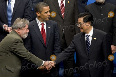 Hu Jintao Photo - Pittsburgh PA - September 25 2009 -- Luiz Inacio Lula da Silva president of Brazil left greets Hu Jintao president of China right as US President Barack Obama looks on before a Group of 20 nations family photo on day two of the G-20 summit in Pittsburgh Pennsylvania US on Friday September 25 2009 G-20 leaders are working on an accord to prevent a repeat of the worst global financial crisis since the Great Depression and ensure a sustained recovery  Photo By Andrew HarrerPool-CNP-PHOTOlinknet