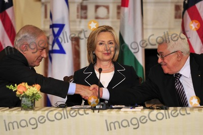 ABBA Photo - United States Secretary of State Hillary Rodham Clinton center smiles as Prime Minister Benjamin Netanyahu of Israel left and Mahmoud Abbas of the Paqlestinian Authority shake hands following their remarks at the start of the Relaunch of Direct Negotiations Between the Israelis and Palestinians in the Benjamin Franklin Room of the US Department of State on Thursday September 2 2010  Credit Ron Sachs  CNP(RESTRICTION NO New York or New Jersey Newspapers or newspapers within a 75 mile radius of New York City)