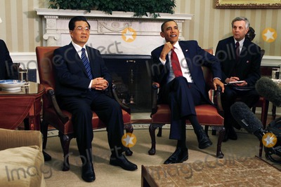 Alex Wong Photo - WASHINGTON DC - JANUARY 19 (AFP OUT) US President Barack Obama (2R) and Chinese President Hu Jintao (L) meet in the Oval Office with interpreters at the White House January 19 2011 in Washington DC Obama and Hu are scheduled to hold a joint press conference and attend a State dinner Photo by  Alex WongPoolCNP-PHOTOlinknet