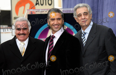 Alejandro Fernandez Photo - Photo by NPXstarmaxinccom200512205Alejandro Fernandez (with Vincent Fernandez and Placido Domingo) receives his star on the Hollywood Walk of Fame(Los Angeles CA)