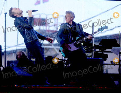 Adam Clayton Photo - Photo by Dennis Van TinestarmaxinccomSTAR MAX2014ALL RIGHTS RESERVEDTelephoneFax (212) 995-119612114Chris Martin and Adam Clayton at a free benefit concert honoring World AIDS Day(Times Square)