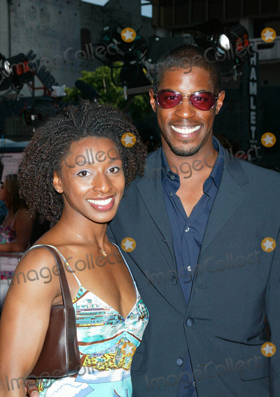 Ahmed Best Photo - Photo by Russ EinhornSTAR MAX Inc - copyright 200251202Ahmed Best and Racquel Horsford at The Star Wars Premiere(Graumans Chinese Theatre Hollywood CA)