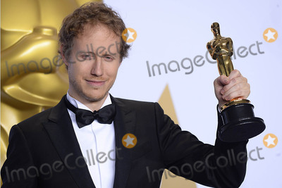 Laszlo Nemes Photo - Photo by PDstarmaxinccomSTAR MAXCopyright 2016ALL RIGHTS RESERVEDTelephoneFax (212) 995-119622816Laszlo Nemes with the Oscar for Hungarian drama Son Of Saul at the 88th Annual Academy Awards (Oscars)(Hollywood CA USA)
