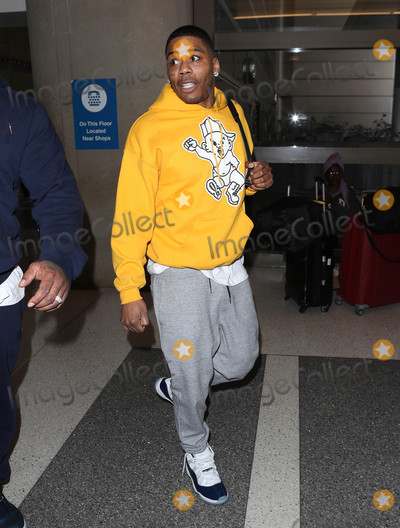 Nelly Photo - Photo by SMXRFstarmaxinccomSTAR MAX2018ALL RIGHTS RESERVEDTelephoneFax (212) 995-119621418Nelly is seen at LAX Airport in Los Angeles CA