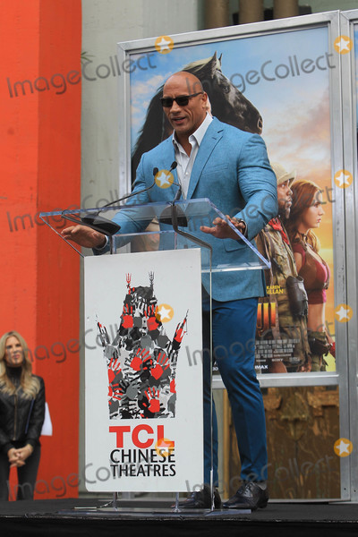 Dwayne Johnson Photo - Photo by SMXRFstarmaxinccomSTAR MAX2019ALL RIGHTS RESERVEDTelephoneFax (212) 995-1196121019Dwayne Johnson at a Hand and Footprint Ceremony at the TCL Chinese Theatre IMAX in Hollywood CA