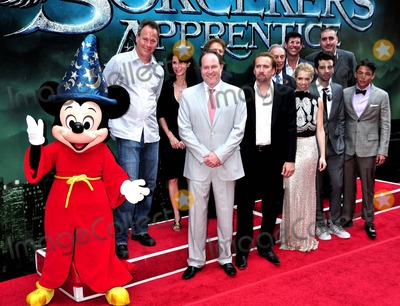 Alfred Molina Photo - Jon Turteltaub Katherine Oliver Nicolas Cage Jerry Bruckheimer Teresa Palmer New York City Mayor Michael Bloomberg Jay Baruchel Gregory Woo and Alfred Molina are joined on the red carpet by Mickey Mouse for the premiere of Disneys The Sorcerers Apprentice held at the New Amsterdam Theatre in Times Square  Bloomberg reportedly named the day Sorcerers Apprentice Day to welcome and promote the film  New York NY 070610