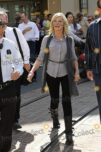 Olivia Newton-John Photo - Actress Olivia Newton-John is all smiles as she arrives for an open-air interview on the American show Extra at the Grove shopping center to promote her latest project 1 a Minute a documentary about breast cancer survivors released on October 6th  Newton-John a breast cancer survivor was very animated and appeared very happy during her interview Los Angeles CA 100710