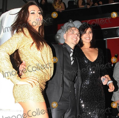 Ana Carolina da Fonseca Photo - Rapper Pitbull (aka Armando Christian Perez) celebrates his 30th birthday at Play nightclub with friends that included Mexican pop singer Cristian Castro former Major League Baseball player Sammy Sosa Brazilian-born actress Ana Carolina da Fonseca who surprised Pitbull when she walked out of a giant faux cake and Latin pop singer and actor Jencarlos Canela  Pitbull appeared to be in a great mood as he kissed and hugged Ana Carolina stuck out his tongue and posed with a comical sculpture of himself Pictured Pitbull and Ana Carolina da Fonseca Miami FL 011511