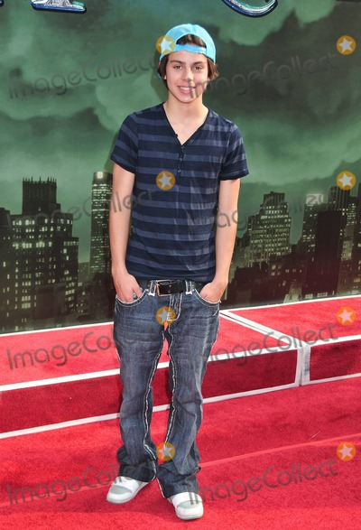 Jake T Austin Photo - Jake T Austin walks the red carpet for the premiere of Disneys The Sorcerers Apprentice held at the New Amsterdam Theatre in Times Square  New Yorks mayor Michael Bloomberg reportedly named the day Sorcerers Apprentice Day to welcome and promote the film  New York NY 070610