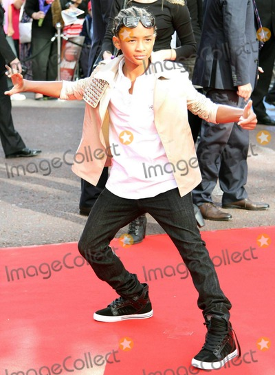 Willow Smith Photo - Jaden Smith arrives for the UK premiere of The Karate Kid held at Odeon Leicester Square  Young and fashionable Smith the star of the remake seemed to have fun infront of the cameras striking a karate pose in a studded jacket  Jaden was joined by his equally fashionable family dad Will Smith mom actress Jada Pinkett Smith who donned a neutral large-sequin mini dress and sister Willow Smith who wore Union Jack patterned leggings Converse sneakers and a leather jacket  The family was seen arriving together in a silver Mercedes van London UK 071510