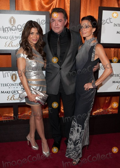 Shareef Malnik Photo - Paula Abdul walks the red carpet with English actress Gabrielle Anwar and Anwars boyfriend Miami restaurateur Shareef Malnik at the 16th Annual Intercontinental Miami Make-A-Wish Ball Miami FL 110610