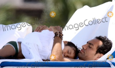 Alessandro Nesta Photo - EXCLUSIVE World Cup-winning Italian soccer star Alessandro Nesta spends a family day at the beach with wife Gabriela Pagnozzi daughter Sofia and son Tommaso The family seemed to enjoy a relaxing day together and Alessandro held little Tomasso on his chest while he slept Nesta who plays as a defender for Serie A club Milan is considered by many as one of the best centre backs to have ever played and is a four-time member of the aunnual UEFA Team of the YearFees must be agreed prior to publication