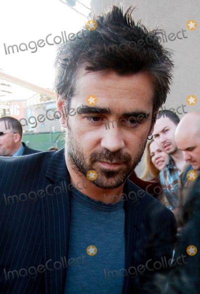 Alicja Bachleda Photo - Irish bad boy actor Colin Farrell arrives via the back door at the Jimmy Kimmel Live studio to appear on the ABC talk show  Farrell 34 was at the show to promote his latest film Ondine a drama that was filmed in Farrells home country and is being released in the US on June 4th  The Golden Globe and IFTA award winner happily signed autographs posed for photos with fans and despite looking a bit scruffy with his messy hair and beard looked sharp in a pinstriped jacket  Farrell who is dating his Ondine co-star actress Alicja Bachleda wore a ring on his wedding ring finger Los Angeles CA 060310