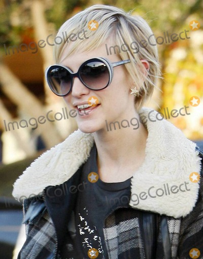 Ashlee Simpson-Wentz Photo - Ashlee Simpson-Wentz shows off her recently cropped pixie hairdo as she leaves a West Hollywood salon where she got her blonde do touched up and met with soon to be married Nicole Richie  Ashlee who will reportedly be one of 75 guests at Nicoles very exclusive and secretive Bel Air wedding looked very happy as she left the salon  Ashlee also looked very fashionable and very slim in her trendy plaid winter jacket black nylons with denim cutoff shorts lace up heels and worn tee Los Angeles CA 120910
