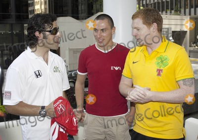 Neil Lennon Photo - Scottish race car driver Dario Franchitti who is married to actress Ashley Judd chats and poses with Scottish footballer Scott Brown of the Celtics and Celtic manager Neil Lennon during a photo op at the Duke of Devon pub in Toronto  The trio spoke with reporters and exchanged a jersey as Franchitti is a Celtics fan  Franchitti is in town for the 2010 Honda Indy Toronto taking place July 16-18 and the Celtics are gearing up for their overseas match with Manchester United tomorrow at Torontos Rogers Centre Pictured (L-R) Dario Franchitti Scott Brown Neil Lennon Toronto ON 071510