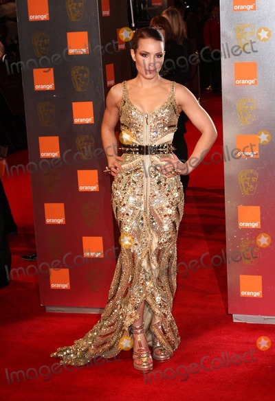 Noomi Rapace Photo - Noomi Rapace poses for photographers on the red carpet at the 2011 Orange British Academy Film Awards held at The Royal Opera House in Covent Garden London UK 021311