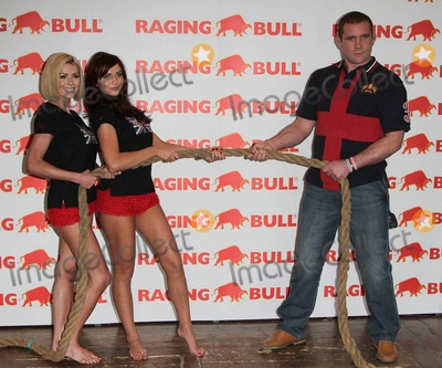 Amy Childs Photo - Glamor model Nicola McLean (L) and Amy Childs of the ITV2 reality show The Only Way Is Essex wear red ruffled underwear and Union Jack tops at the launch of Raging Bull Leisurewear where they had fun playing tug of war with rugby star Phil Vickery London UK 121310